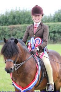 Zara Scudamore and Moortown Honeyboy going Ridden Supreme Champions at the Championship Breed Show 2015