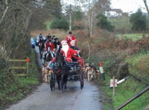 Mrs. Jo Green and Dunmere Glayvar escorting Tiverton Foxhounds to the meet on Christmas Eve